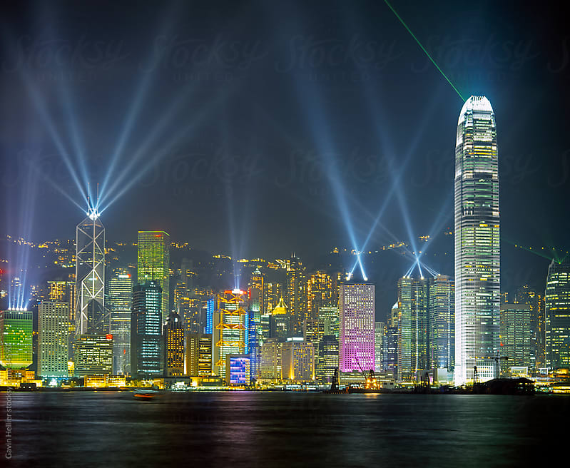 Hong Kong city skyline looking across Victoria harbour to Hong Kong Island at night, Hong Kong, China, Asia by Gavin Hellier for Stocksy United