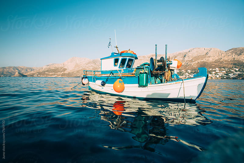 Small Greek fishing boat by Micky Wiswedel for Stocksy United