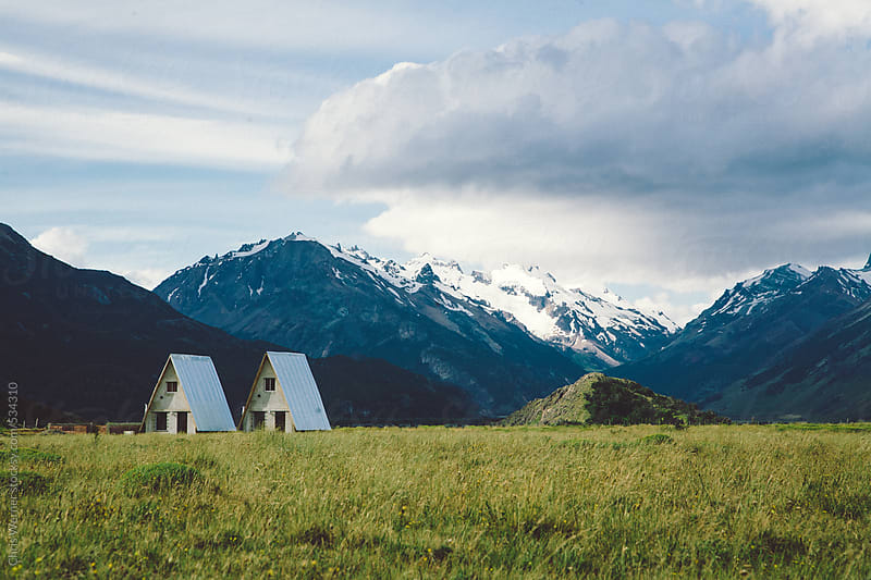 Twin houses in the mountains by Chris Werner for Stocksy United