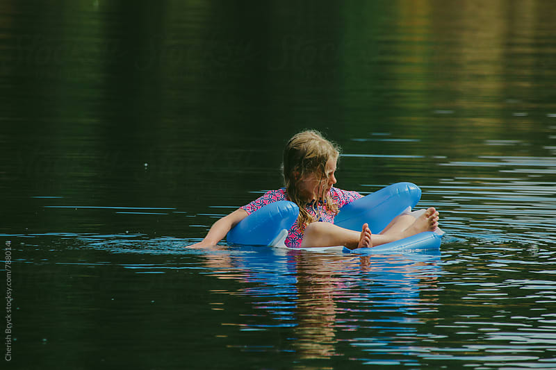 Floating on the lake. by Cherish Bryck for Stocksy United