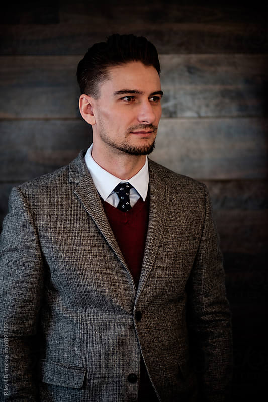 A portrait of a dapper dressed gentleman looking to his left. by Riley Joseph for Stocksy United