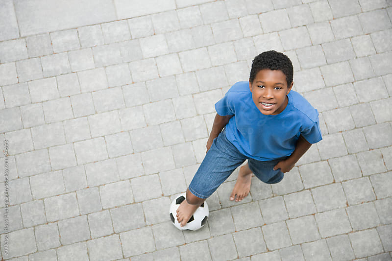 Portrait of boy (10-11) with ball outdoors by Andersen Ross Photography for Stocksy United