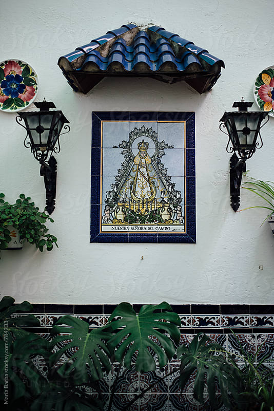 Mosaic of Virgin Mary inside of an andalusian patio by María Barba for Stocksy United