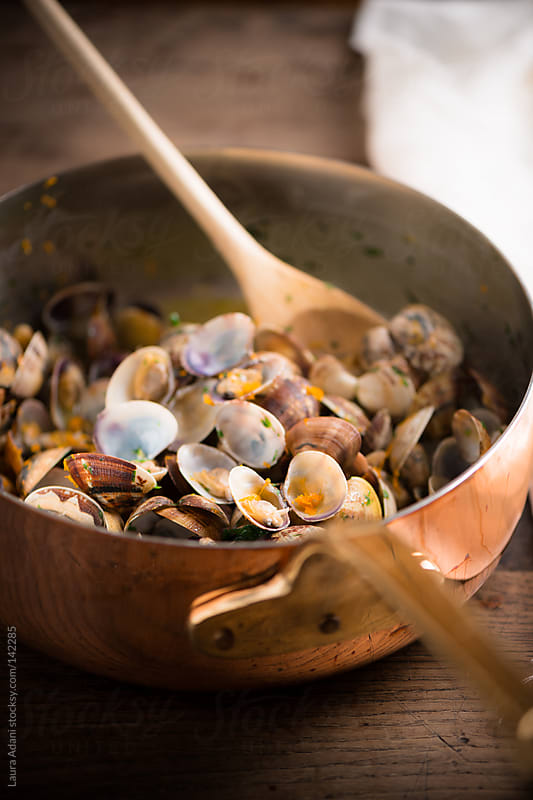 clams in a saucepan by Laura Adani for Stocksy United