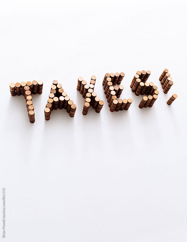 taxes spelled in stacks of pennies by Brian Powell for Stocksy United