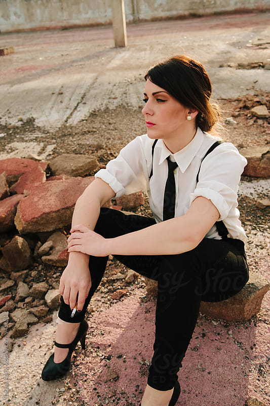 Young beautiful woman sitting on the ground by Natasa Kukic for Stocksy United