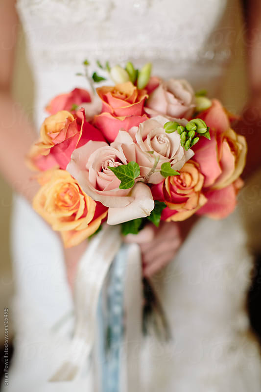closeup of bride's bouquet by Brian Powell for Stocksy United