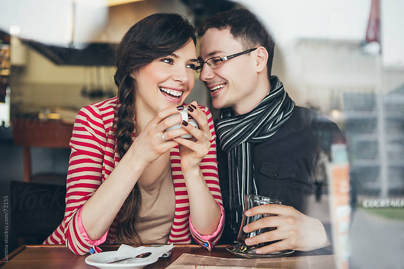 Smiling Couple Enjoying at a Cafe by Lumina for Stocksy United