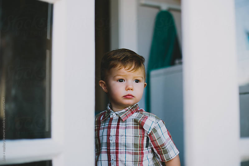 Little Boy Standing in the Doorway by luke + mallory leasure for Stocksy United