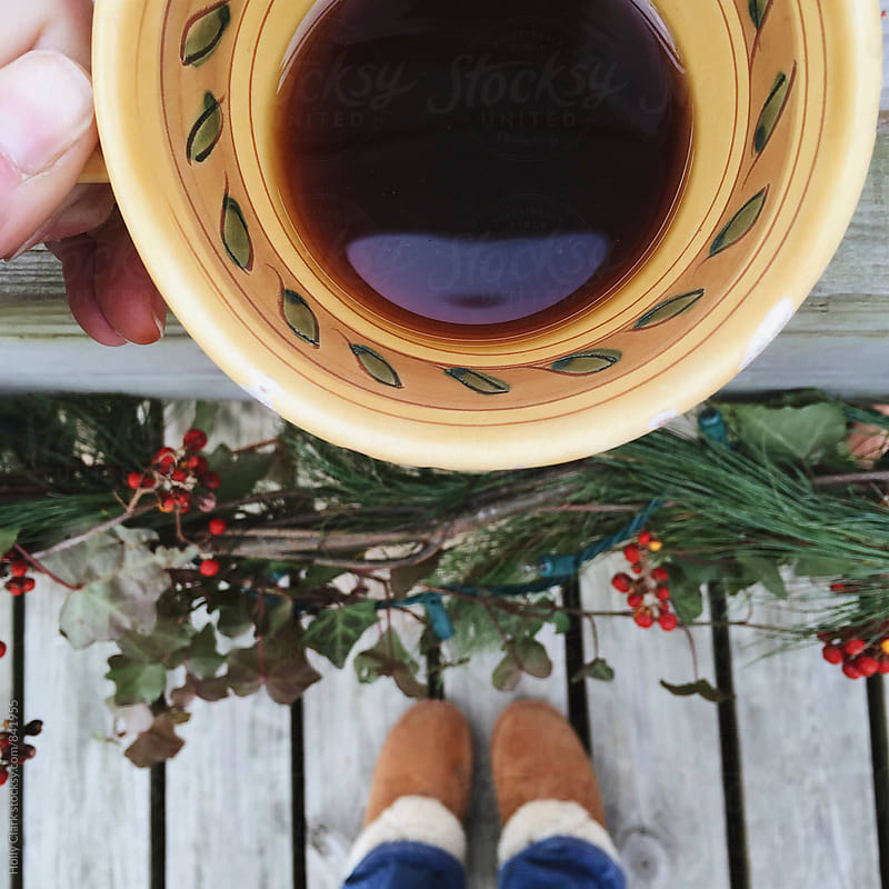 Coffee with Natural Christmas decorations by Holly Clark for Stocksy United