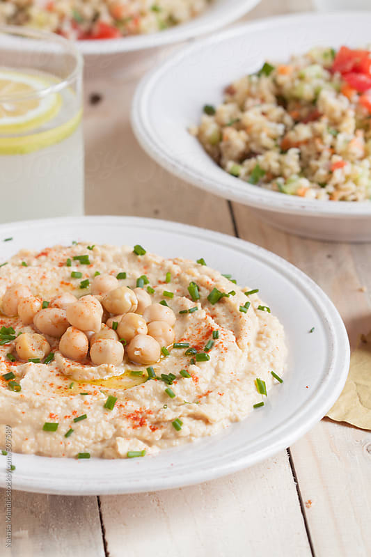 Hummus and Tabbouleh  by Nataša Mandić for Stocksy United