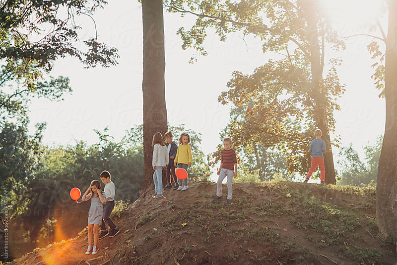 Group of Kids Playing Outdoors by Lumina for Stocksy United