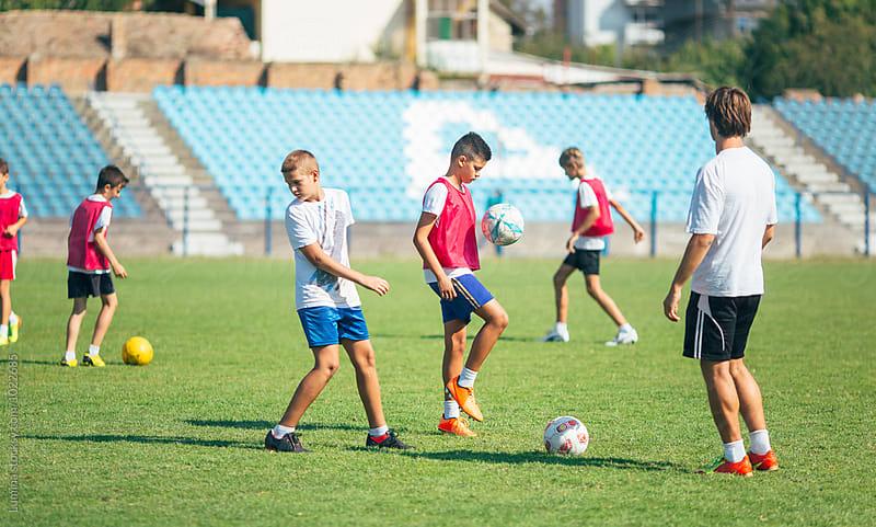 Caucasian Boys Training Football by Lumina for Stocksy United