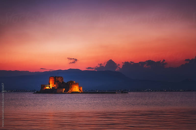 Sunset at Bourtzi Castle in Nafplio, Greece by Helen Sotiriadis for Stocksy United