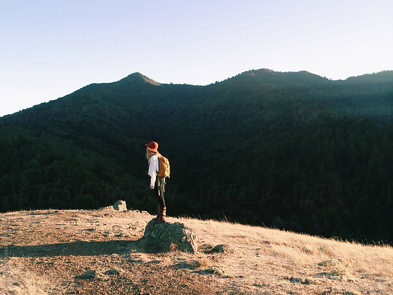 Woman Standing on Mountain Rock by Kevin Russ for Stocksy United