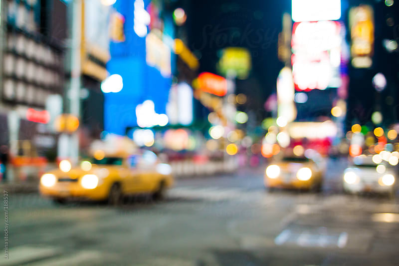 Cabs in Times Square Defocused by Lumina for Stocksy United