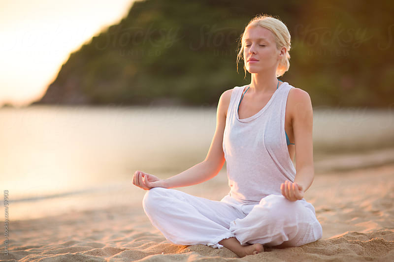Woman Meditating at the Beach by Lumina for Stocksy United