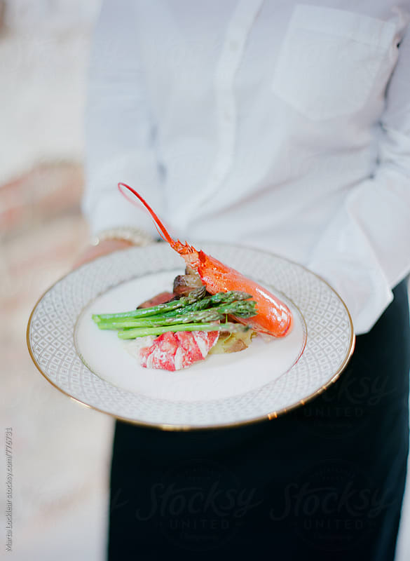 Lobster and Asparagus Dinner by Marta Locklear for Stocksy United