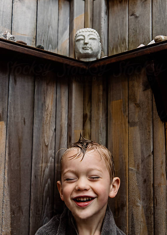 Happy Child in outdoors Shower by Raymond Forbes LLC for Stocksy United