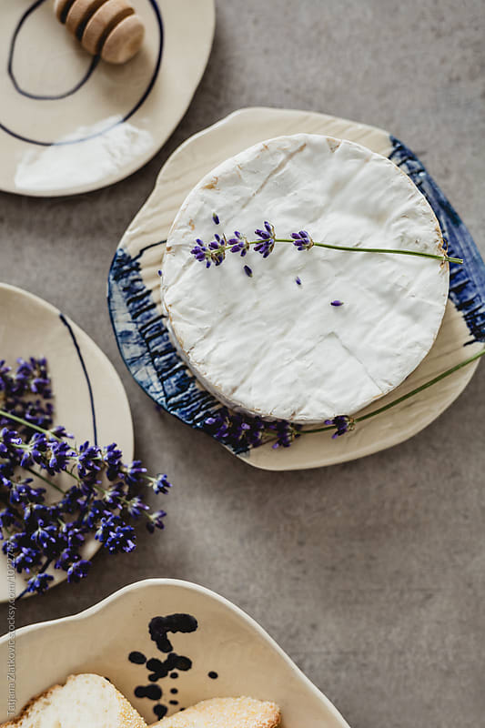Artistic plate with camembert and lavender by Tatjana Ristanic for Stocksy United