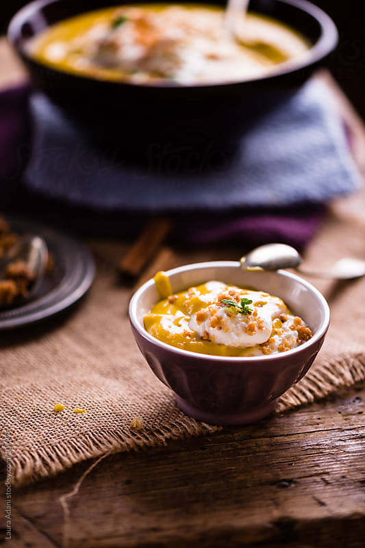 a bowl with pumpkin cream with amaretti crumble by Laura Adani for Stocksy United