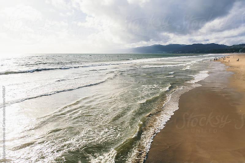 Cloudy view of beach in Santa Monica, California by Alejandro Moreno de Carlos for Stocksy United