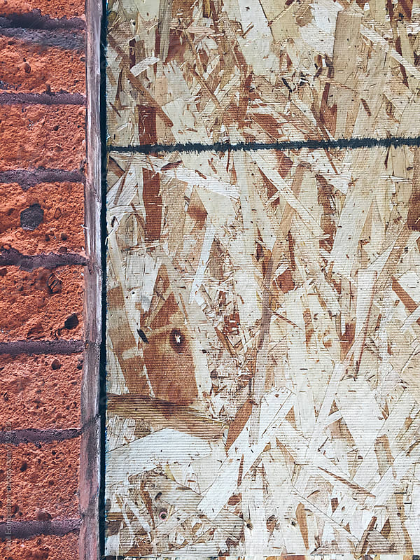 Close up of plywood and brick by Paul Edmondson for Stocksy United