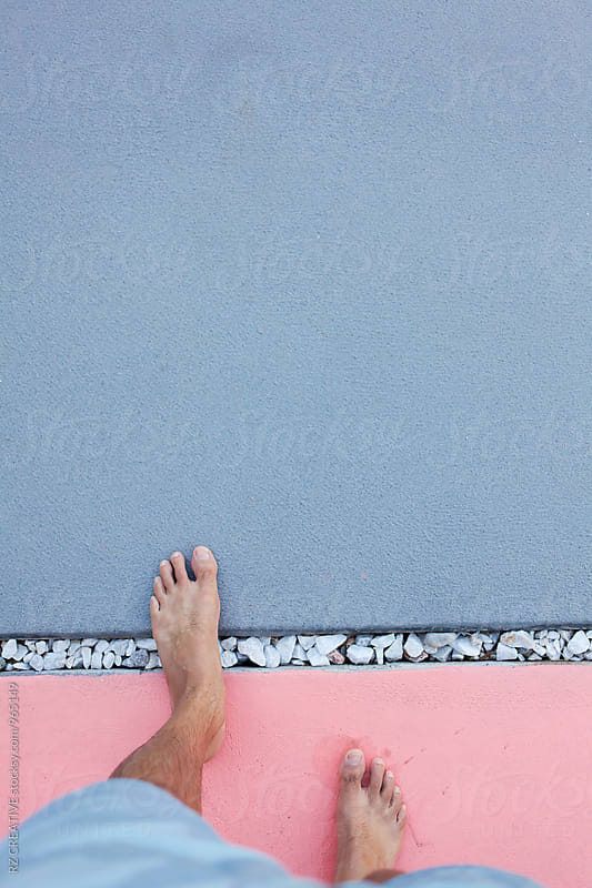 Picture of man's feet on pink and grey floor. by RZ CREATIVE for Stocksy United