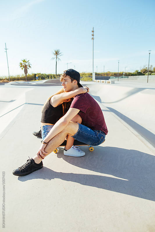 Teenage couple in love embracing together in a skate park. by BONNINSTUDIO for Stocksy United