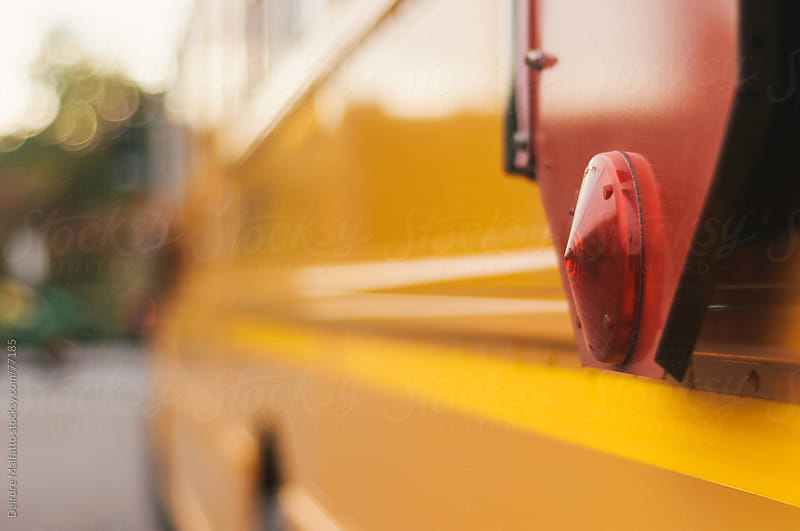 close up of yellow school bus by Deirdre Malfatto for Stocksy United