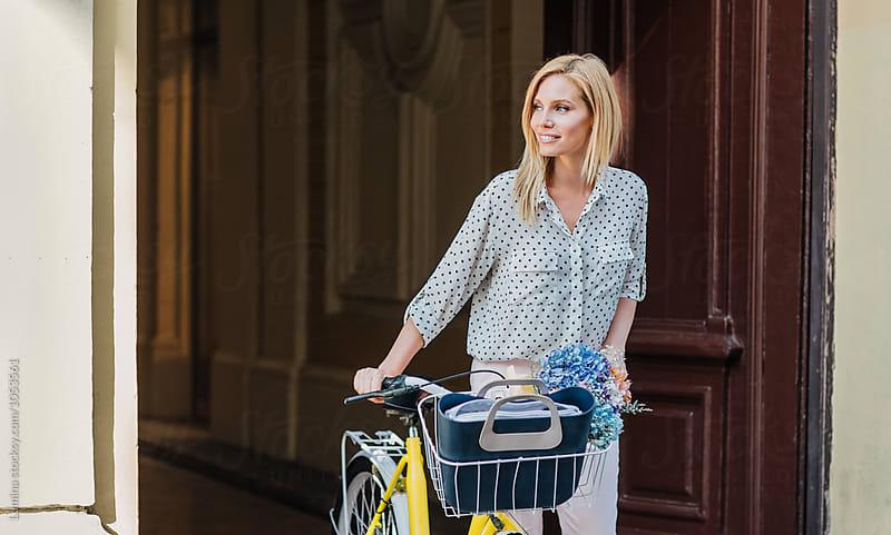 Woman Pushing a Bike by Lumina for Stocksy United
