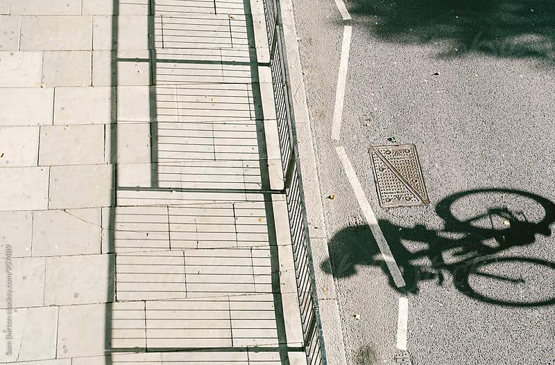 Cyclist shadow by Sam Burton for Stocksy United