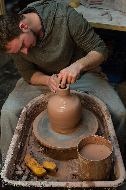 potter on a wheel by Brian Powell for Stocksy United