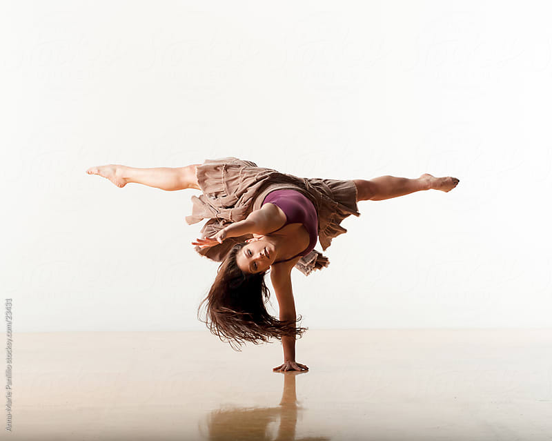 Strong and flexible woman dancing by Anna-Marie Panlilio for Stocksy United