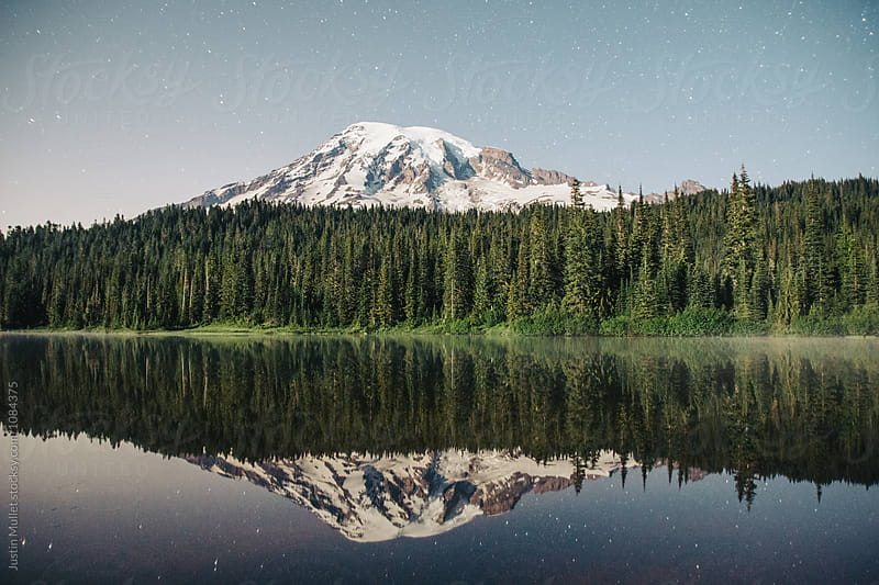 Mt. Rainier reflected in pristine lake by Justin Mullet for Stocksy United