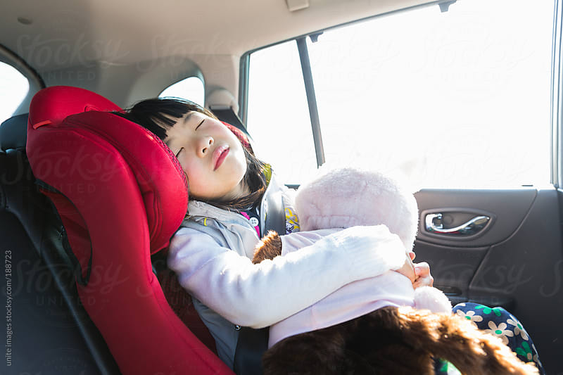 little girl in a car by unite images for Stocksy United