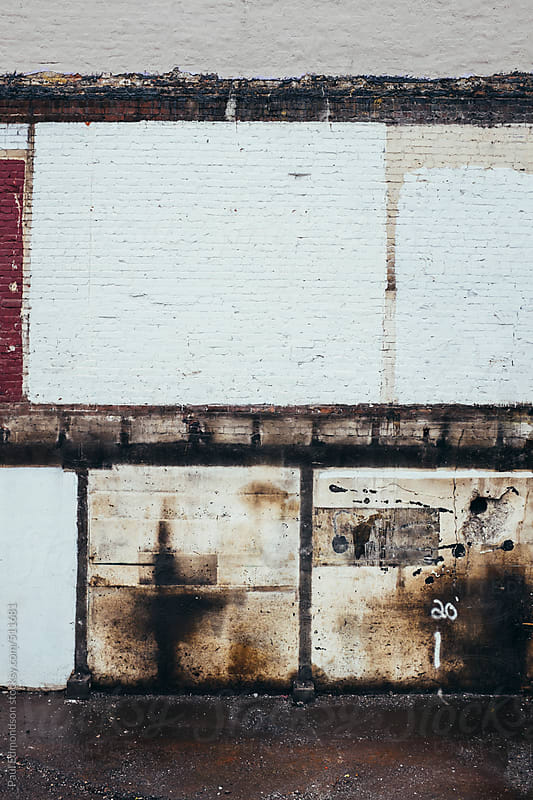 Detail of painted, old and weathered wall of demolished building by Paul Edmondson for Stocksy United
