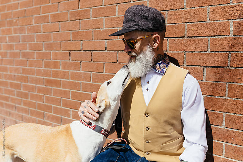 Stylish Old Man With Tattoos With His Pet . Dog by HEX . for Stocksy United