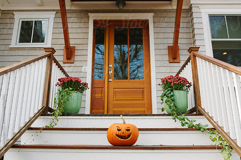House with Halloween Pumpkin Decorations by Raymond Forbes LLC for Stocksy United