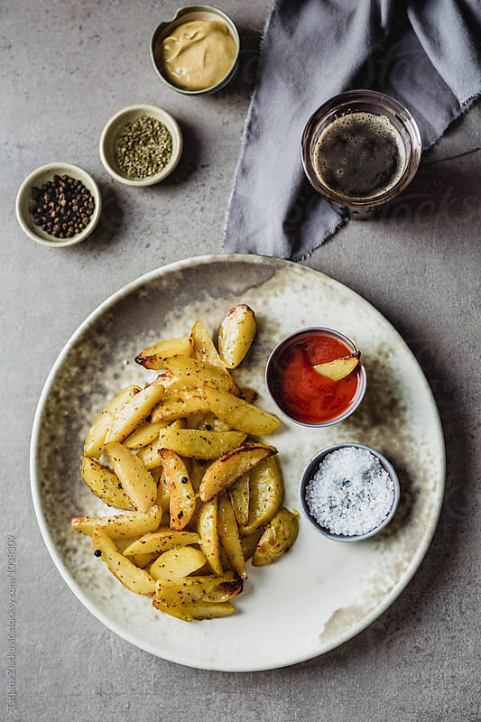 Roasted potatoes with spices by Tatjana Zlatkovic for Stocksy United