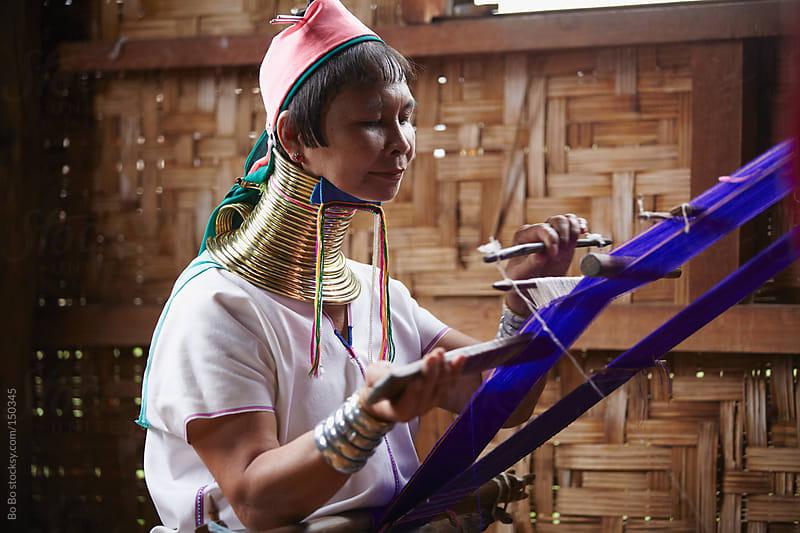 Long neck woman weaving by Bo Bo for Stocksy United