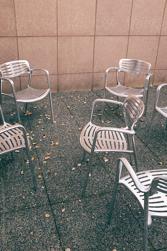Modern chairs on outdoor patio by Paul Edmondson for Stocksy United