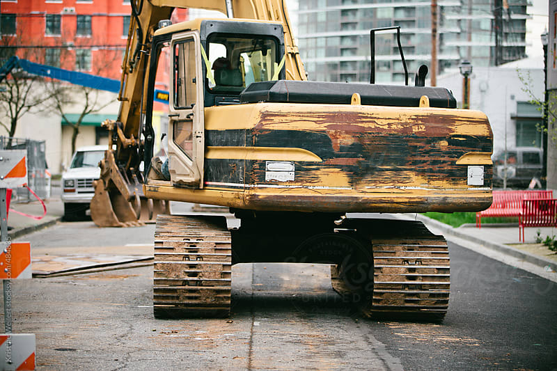 Muddy Excavator at a Construction Site by Kristine Weilert for Stocksy United