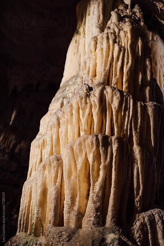 Huge limescale column in Postonja Cave, Slovenia by Lea Csontos for Stocksy United