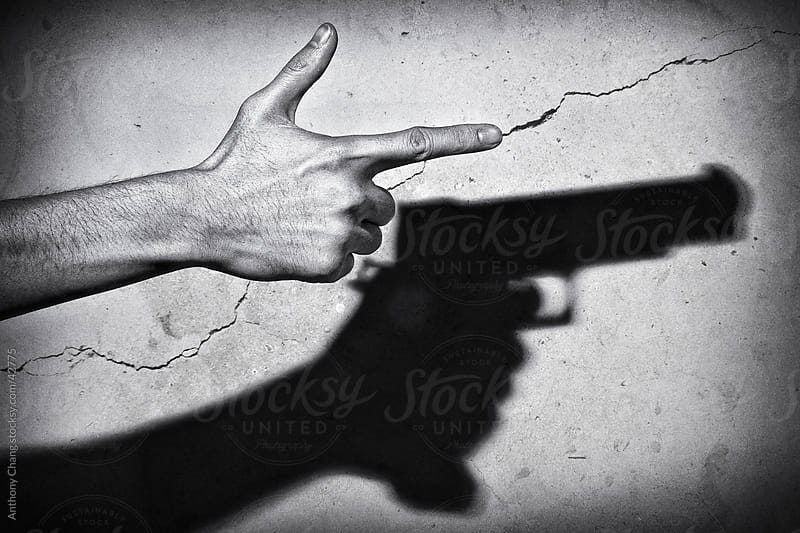 Gun Gesture with Handgun Shadow by Anthony Chang for Stocksy United