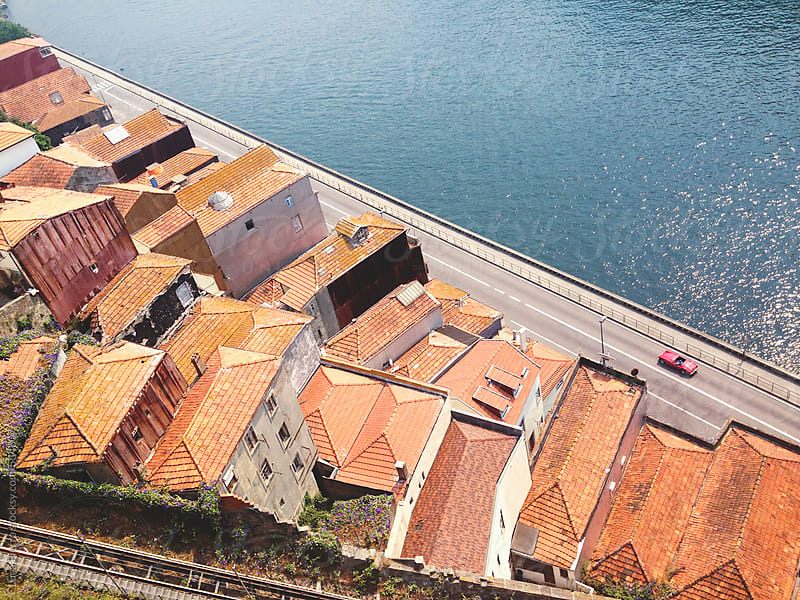 Metro train over Douro's bridge in Porto, Portugal  by Luca Pierro for Stocksy United