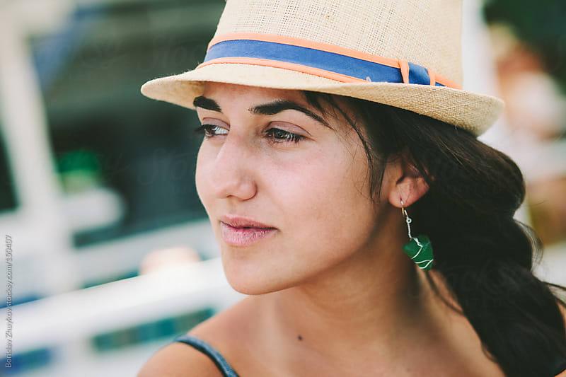 Summer portrait of pretty young woman wearing hat by Borislav Zhuykov for Stocksy United