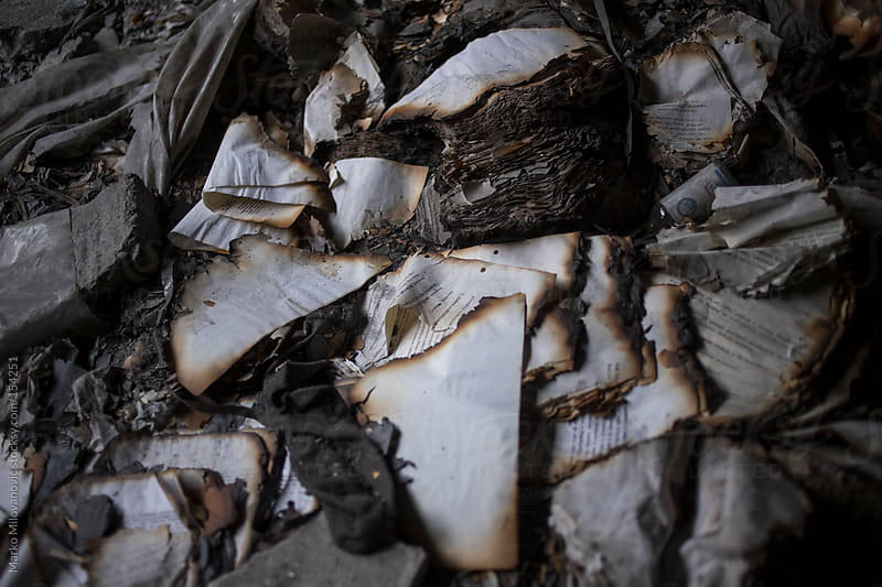 Burnt books, paper by Marko Milovanović for Stocksy United