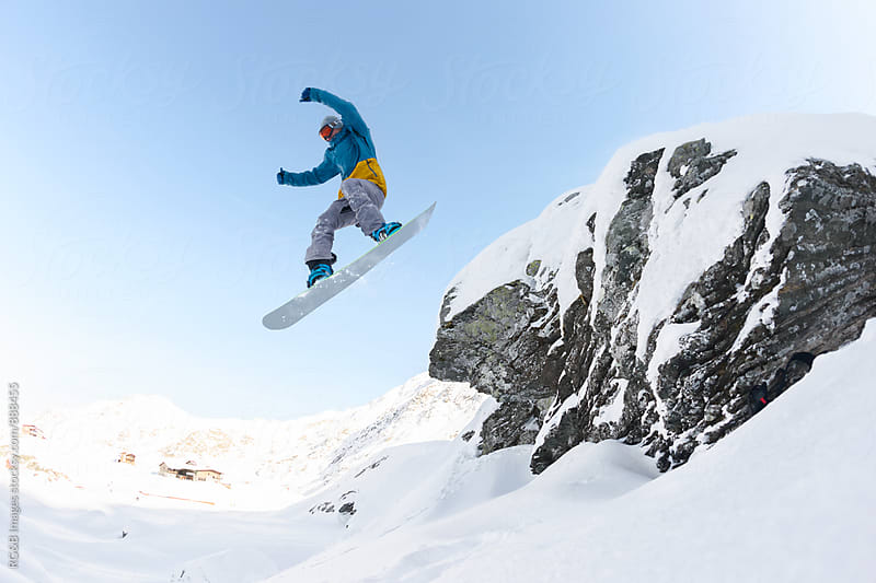 Cool snowboard jump  by RG&B Images for Stocksy United