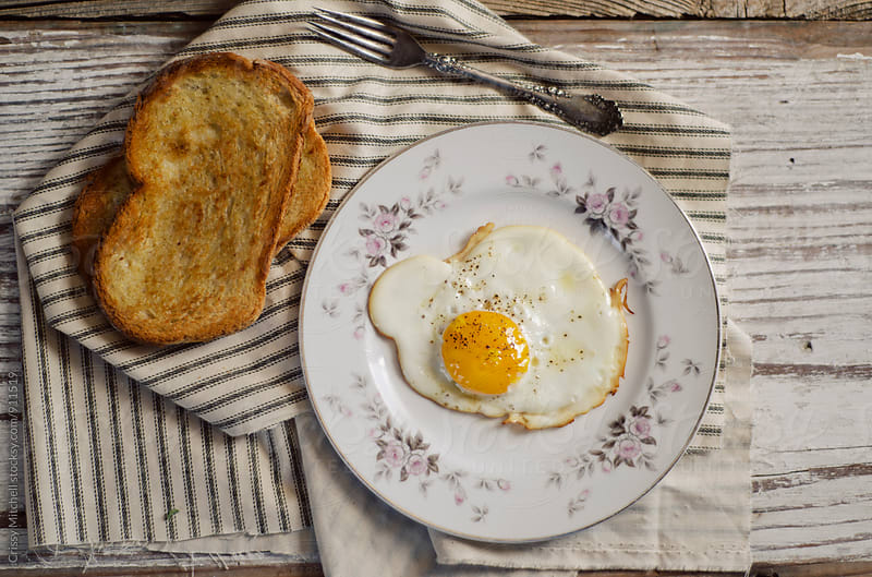 eggs and toast by Crissy Mitchell for Stocksy United